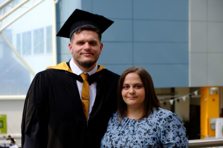 An image of husband and wife, Anthony and Pamela Richardson, on the day of Anthony's Graduation.